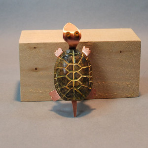 Turtle wood carving by Lora Irish.
