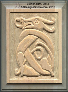using a straight chisel to shape a relief wood carving