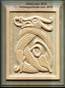 v-gouge detailing in a relief wood carving