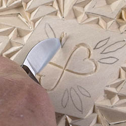 cutting a free form chip in chip carving